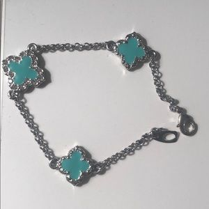 Silver bracelet with teal accents